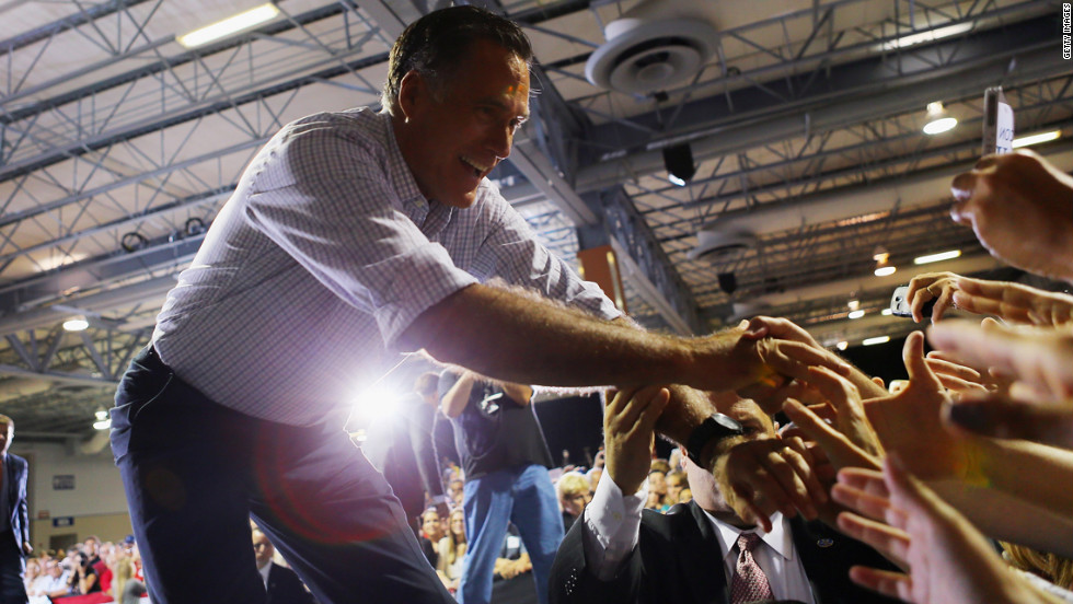 Romney shakes hands with supporters during the Juntos Con Romney Rally in Miami on Wednesday.