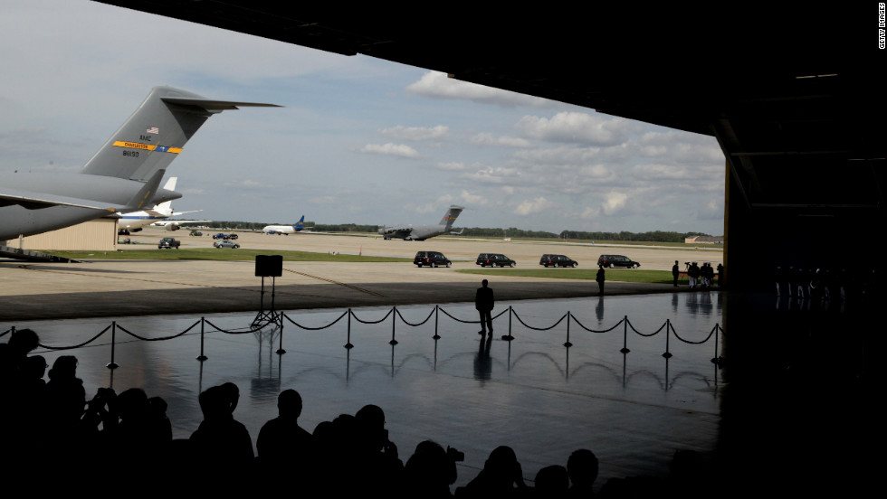 Four hearses carrying caskets leave the hangar during the Transfer of Remains Ceremony for the return of the four Libyan embassy employees on Friday at Joint Base Andrews, Maryland.