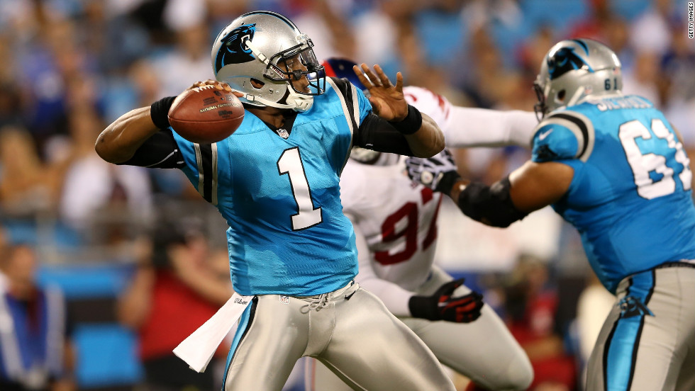 Panthers quarterback Cam Newton throws a pass in the first quarter against the New York Giants on Thursday.