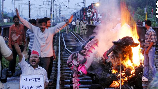 Samajwadi Party workers stop a train in Allahabad on September 20, 2012 in protest at the government's retail reforms.