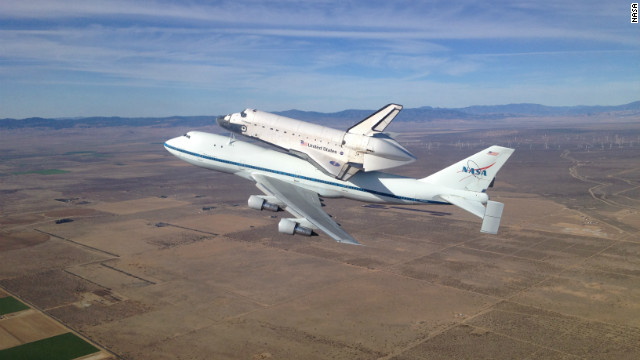 The space shuttle Endeavour atop its modified 747 carrier aircraft soars over the California high desert west of the towns of Rosamond and Mojave on the first leg of its Tour of California Sept. 21. The tour, including numerous flyovers of cities and landmarks in Northern and Southern California, would conclude with a landing at Los Angeles International Airport where Endeavour would be turned over to the California Science Center for permanent exhibit.