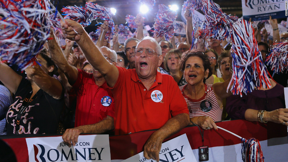 "Supporters cheer as they listen to Romney speak during a Juntos Con Romney Rally at the Darwin Fuchs Pavilion on Wednesday in Miami. <a href=""http://www.cnn.com/SPECIALS/world/photography/index.html"">See more of CNN's best photography</a>."