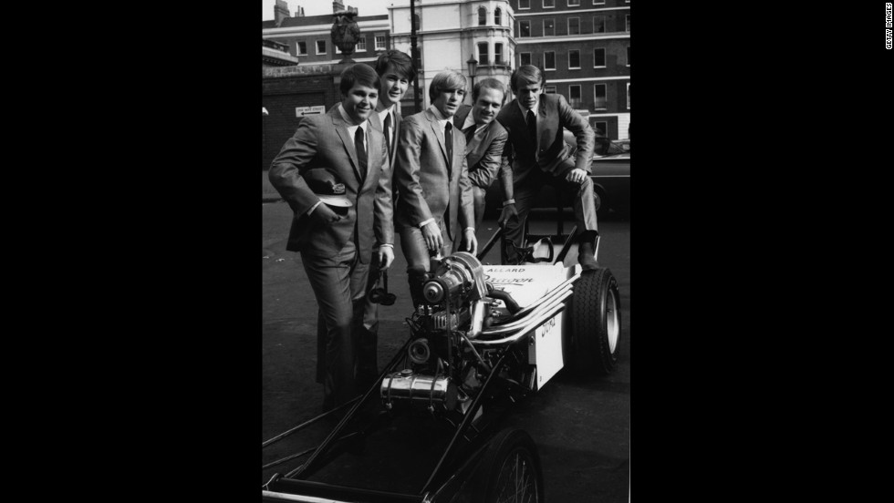 "The Beach Boys pose around a dragster in London's West End during a visit to England in 1964 to promote their new single 'When I Grow Up"" in November 1964"