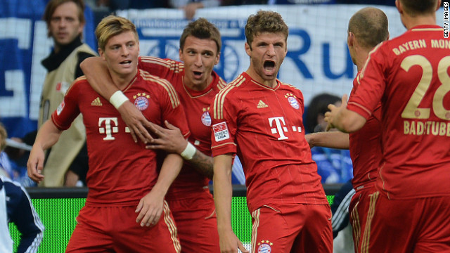 Bayern's players celebrate a goal for Thomas Mueller in their impressive win over Schalke in the Bundesliga.