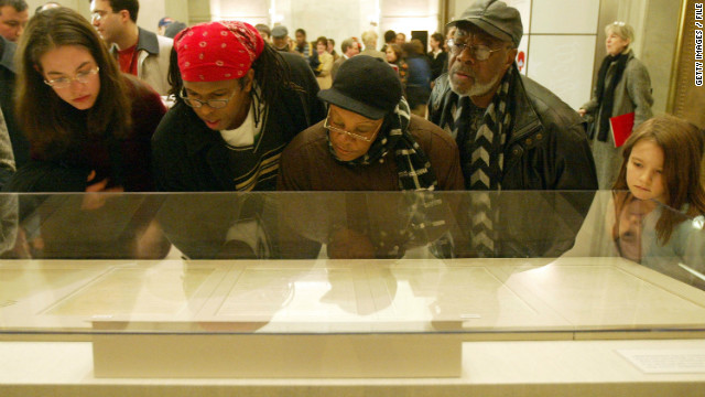 Visitors view the original Emancipation Proclamation during a one-day exhibit January 19, 2003, at the National Archives.