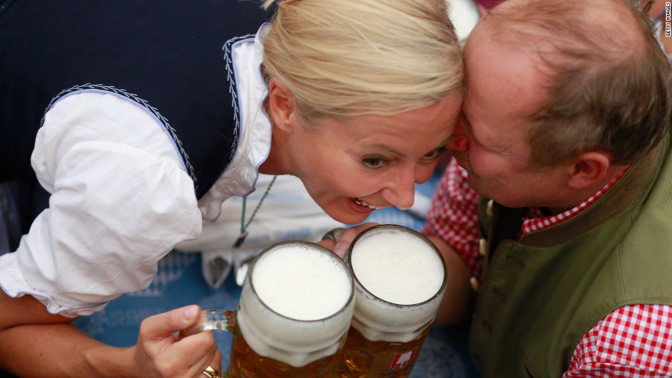 German actor Axel Milberg and his wife, Judith, cheer with beer mugs on Saturday.