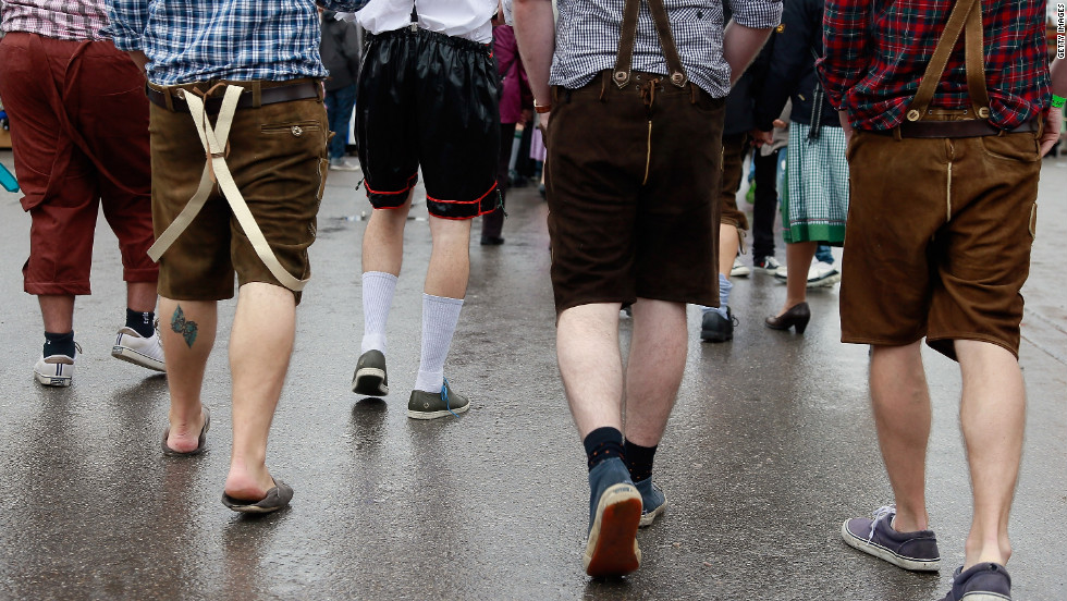 Revelers wearing different types of mock lederhosen walk at the festival.
