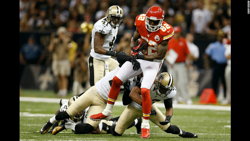 Dwayne Bowe of the Kansas City Chiefs is tackled during Sunday's game against the Saints in New Orleans.