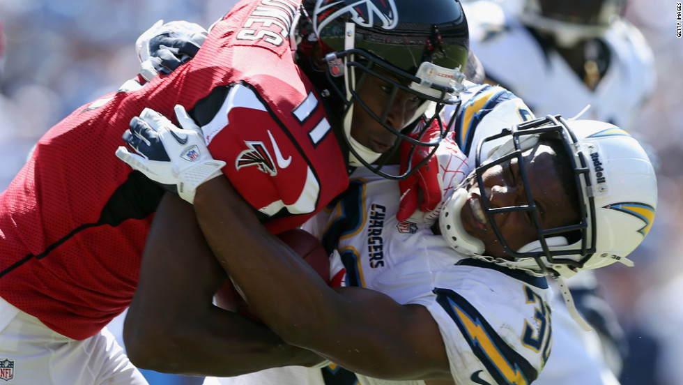 Atlanta's Julio Jones is brought down by San Diego's Marcus Gilchrist.