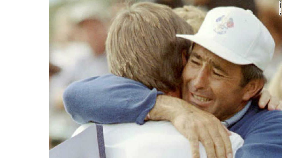 A tearful Ballesteros hugs arch-rival Nick Faldo after the Englishman scored a crucial victory over Curtis Strange as Europe won the 1995 match at Oak Hill.