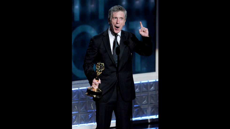 "Tom Bergeron accepts the award for outstanding host of a reality or reality-competition program for ""Dancing With the Stars."""