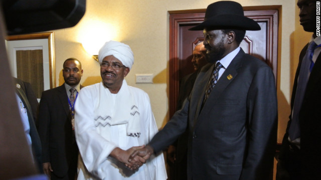Sudanese President Omar Al Bashir, left, shakes hands with South Sudanese President Salva Kiir after a meeting in July 2012.