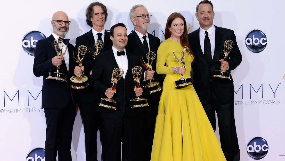 "From left, producer Steven Shareshian, director Jay Roach, writer Danny Strong, producer Gary Goetzman, actress Julianne Moore and producer Tom Hanks show off their awards in the press room for ""Game Change,"" the HBO drama about Sarah Palin and the 2008 election, which won honors for the outstanding miniseries or TV movie. The team also took home Emmys for outstanding casting, outstanding writing, outstanding director for Roach and outstanding actress for Moore in a miniseries or TV movie."