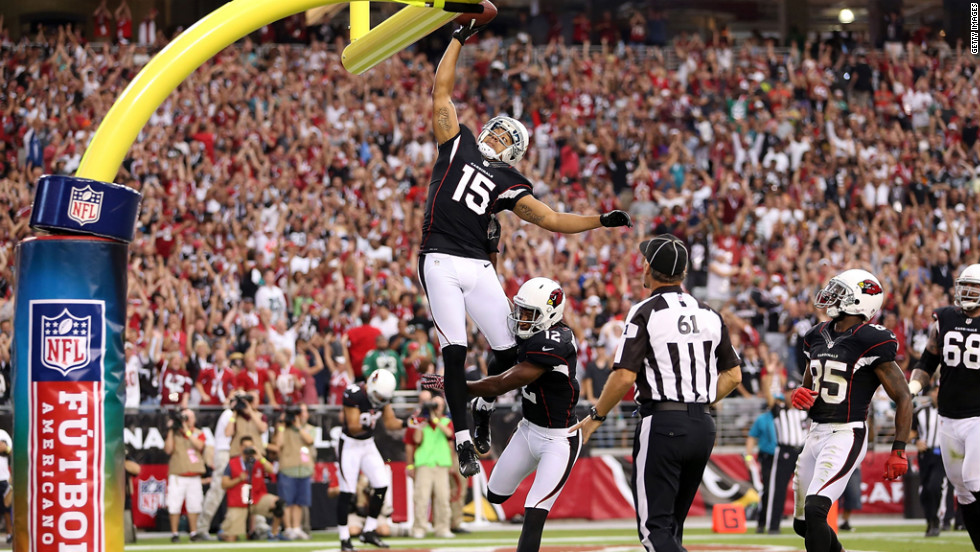 Michael Floyd of the Cardinals celebrates after scoring.