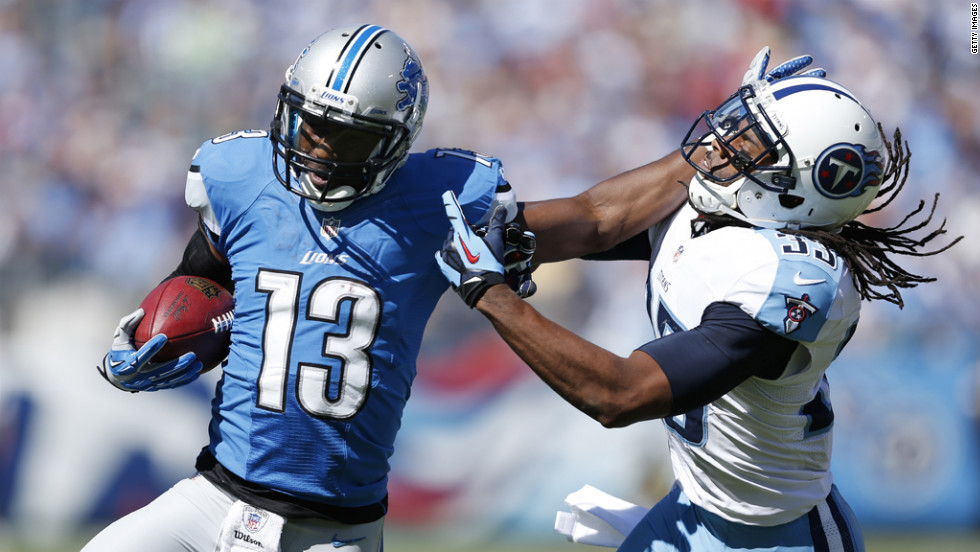 Nate Burleson of the Lions stiff-arms Michael Griffin of the Titans.