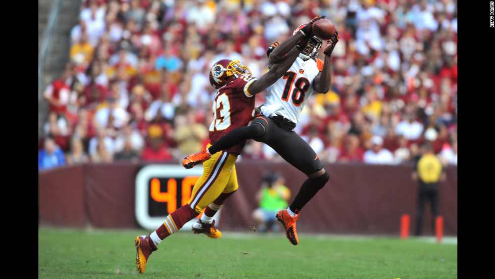 Cincinnati's A.J. Green makes a catch against Washington's DeAngelo Hall.