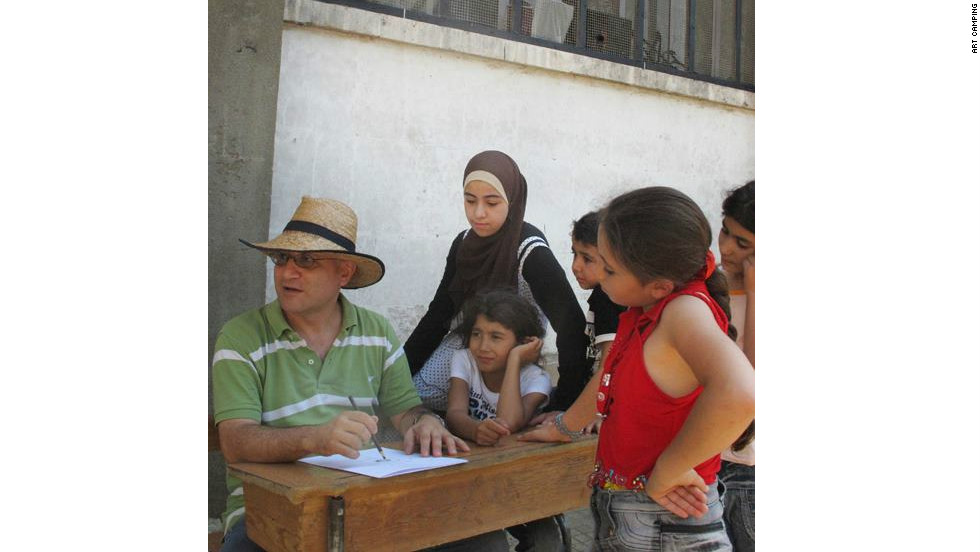 Touma leads a workshop with refugee children in Aleppo in August as part of the Art Camping project.