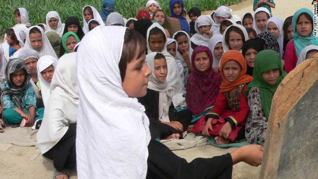 Afghan girls study in an open-air school in the outskirts of Jalalabad.