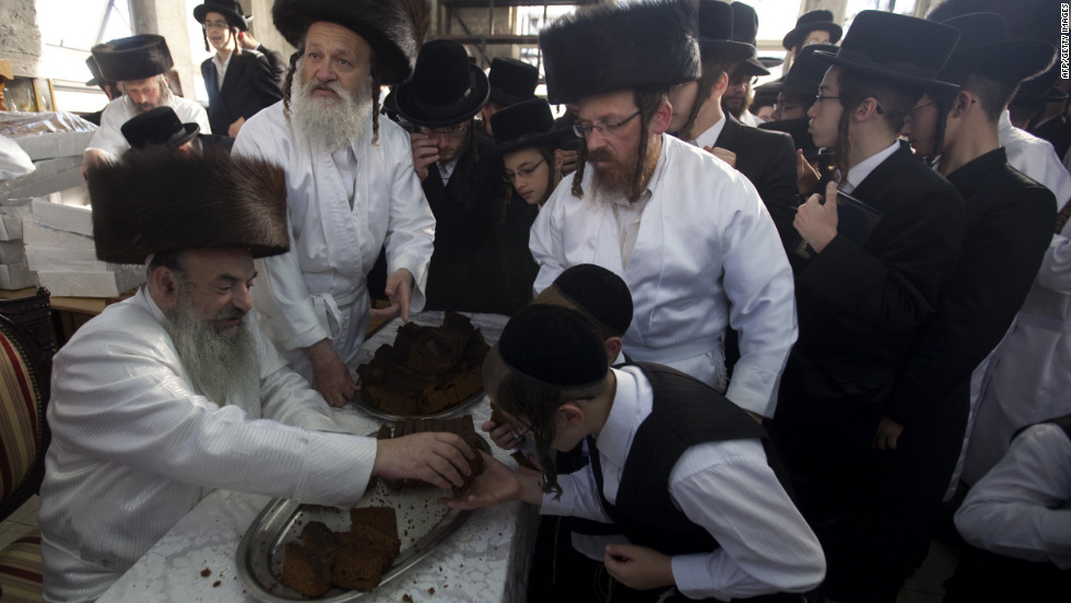 Ultra-Orthodox Jews wear white holiday cloths and eat cake during noon prayers a few hours before the start of Yom Kippur, the Jewish holy day of atonement, on Tuesday, September 25, at a synagogue in the central Israeli town of Bet Shemesh. Yom Kippur, the holiest day in the Jewish calendar, starts at sundown Tuesday.