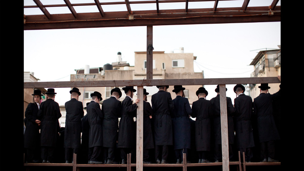 As they perform the Tashlich ritual, Ultra-Orthodox Jews pray together.