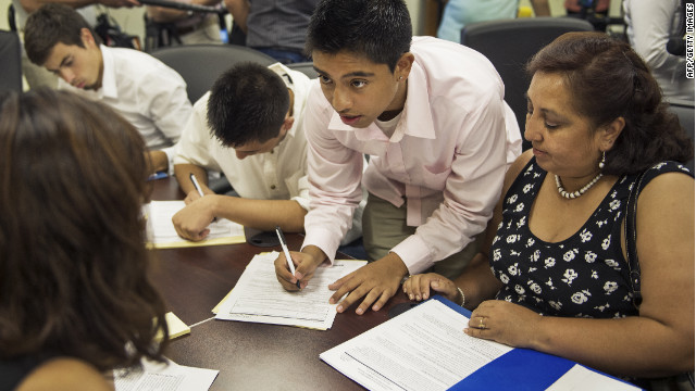 Bolivian Diego Mariaca, center, with his mother, fills out Deferred Action for Childhood Arrivals paperwork in Washington, D.C.