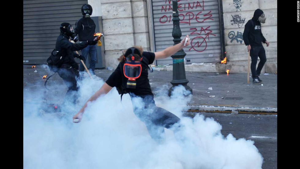 Youths face riot police in Athens on Wednesday.