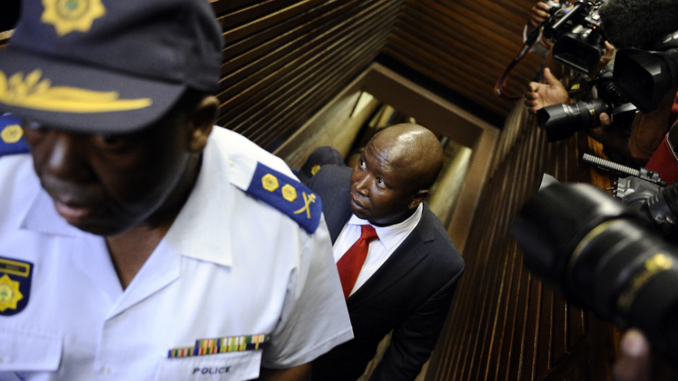 Malema, who was ousted from the ruling African National Congress earlier this year after making a string of attacks against the government, is led into court on September 26. He denies the charges, saying they are politically motivated.