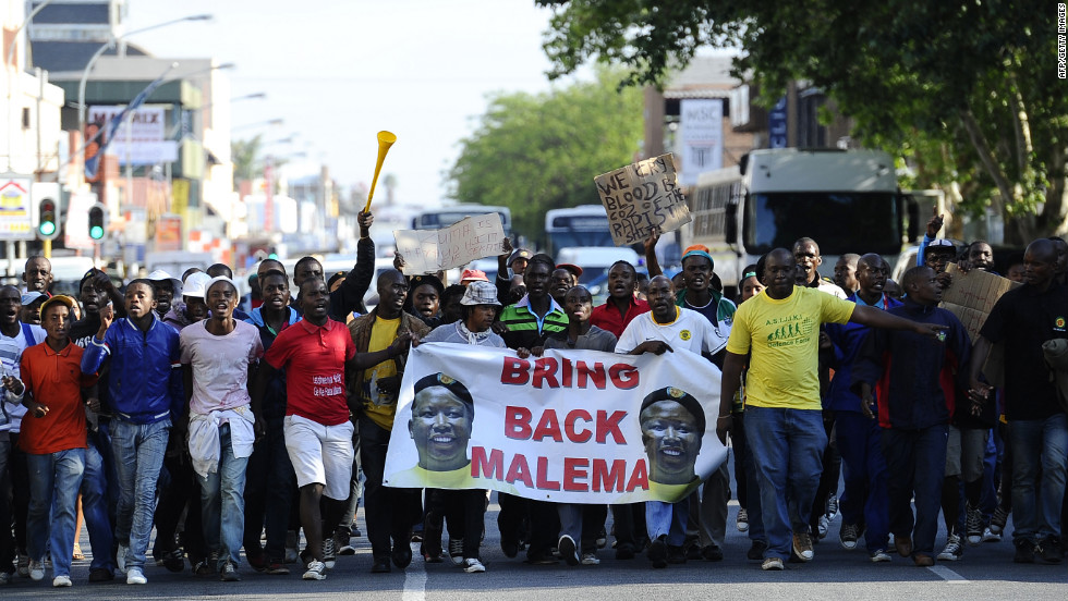 Crowds of supporters gather ahead of Julius Malema's court appearance on September 26. The controversial former leader of the South African ruling party's youth league has split public opinion in recent years.