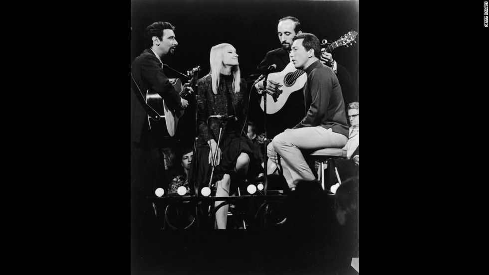 Williams, far right, sings with the folk music trio Peter, Paul and Mary during a TV appearance in 1966.