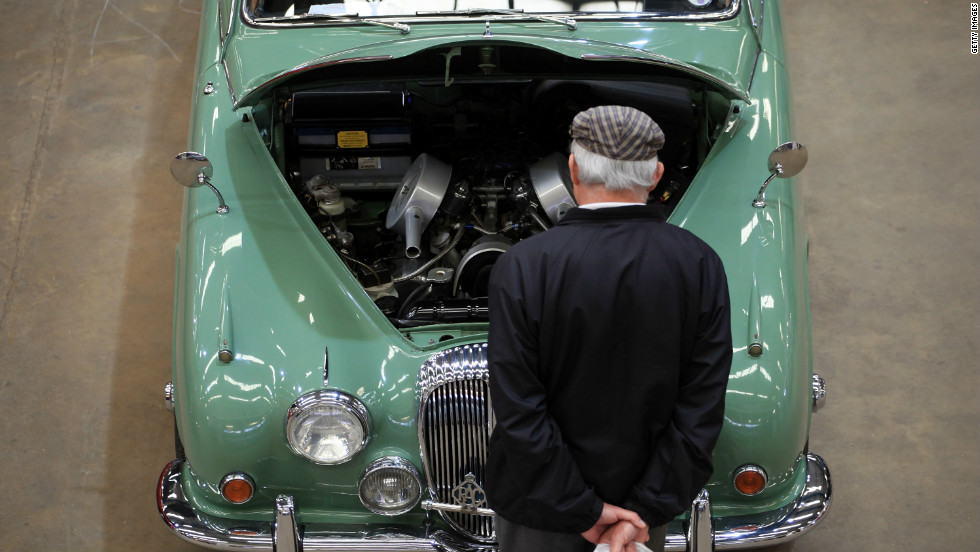 A visitor to the Footman James Bristol Classic Car Show stops to look at a Jaguar classic car on display on April 21, 2012 near Shepton Mallet, England.