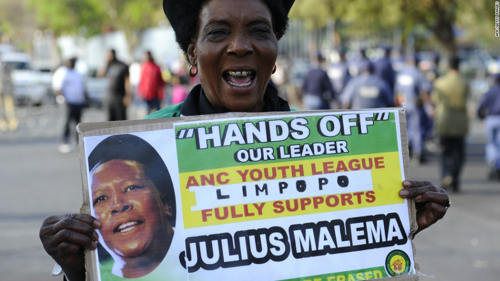 A Malema supporter takes part in a protest near the courthouse on September 26.