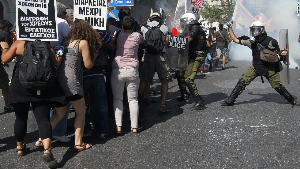 Protesters clash with riot police during the general strike demonstration in Athens on Wednesday.
