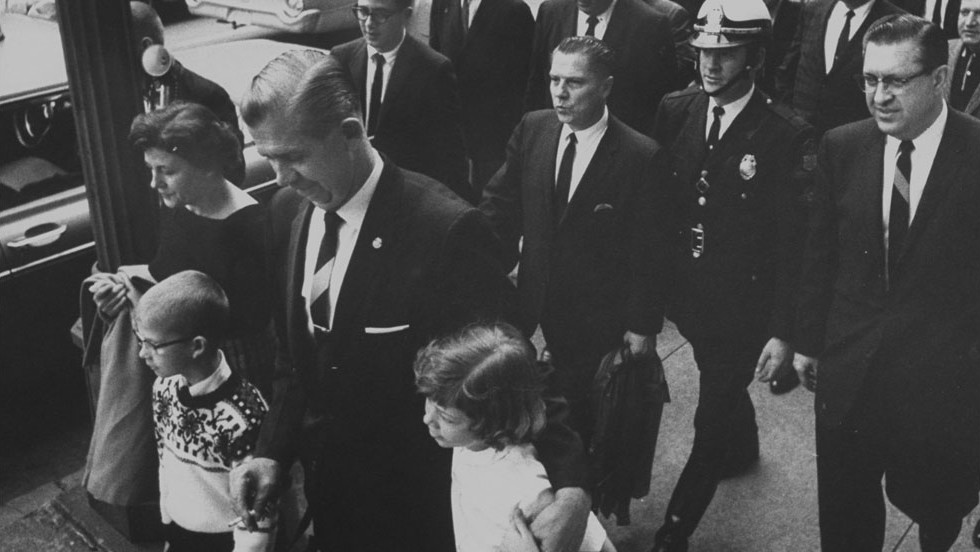 Hoffa, second row, center, leaves court after being found guilty of jury tampering in 1964.