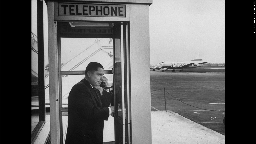 Hoffa on the phone at an airport in 1959.
