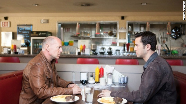 "Bruce Willis plays Joseph Gordon-Levitt's future self in  ""Looper."""