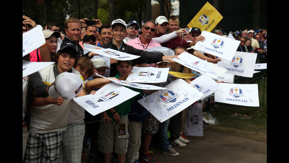 Fans wait for autographs during Thursday's practice round.