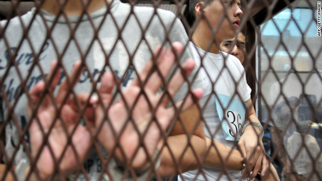 Suspected members of the Zetas drug cartel wait in court for a judgment in Guatemala City on June 27, 2012.