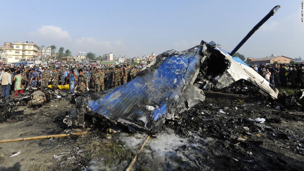 Members of the Nepalese rescue team gather around the wreckage. Officials have recovered the plane's flight data recorder, an airport official said.