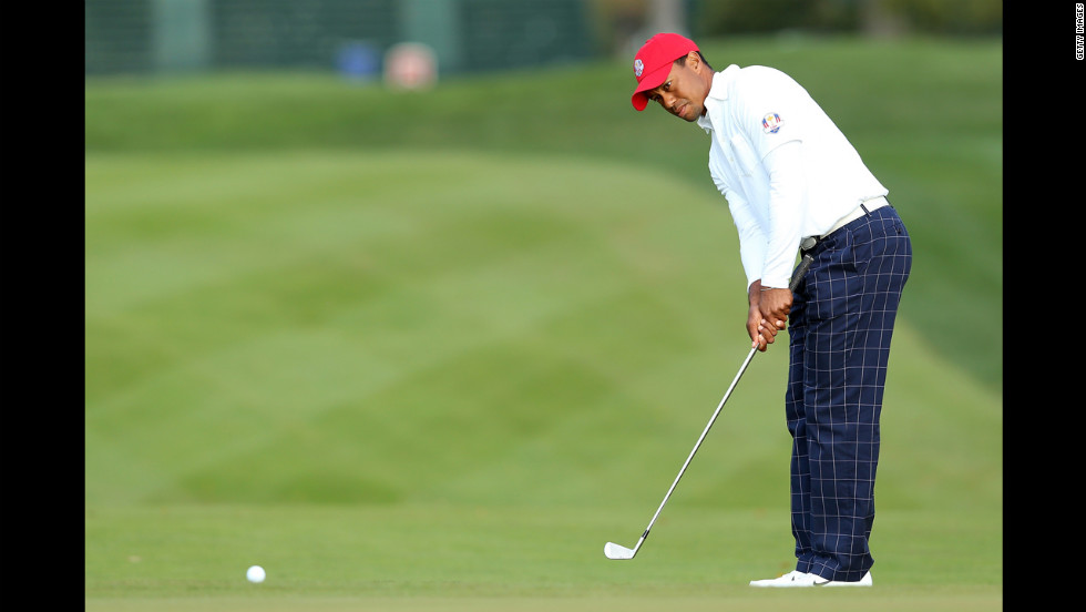 American golfer Tiger Woods chips on the first hole.
