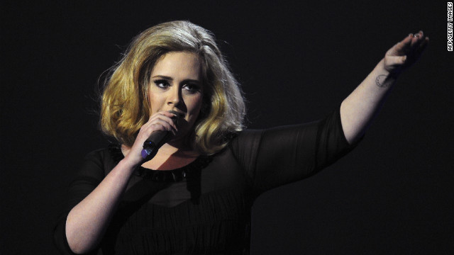 British singer-songwriter Adele accepts the British Female Solo Artist award at the BRIT Awards 2012 in London on February 21, 2012.
