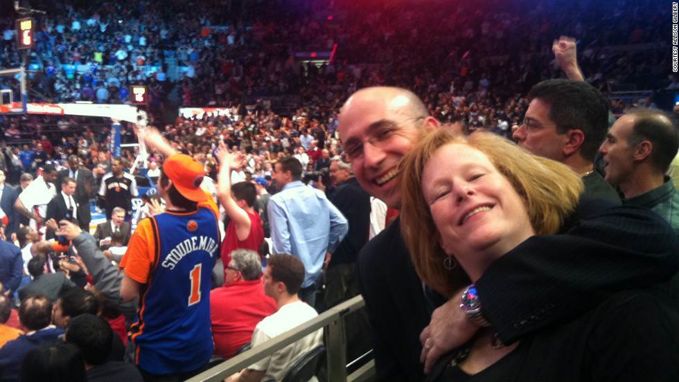 Gilbert and her husband, Mark, at a basketball game.