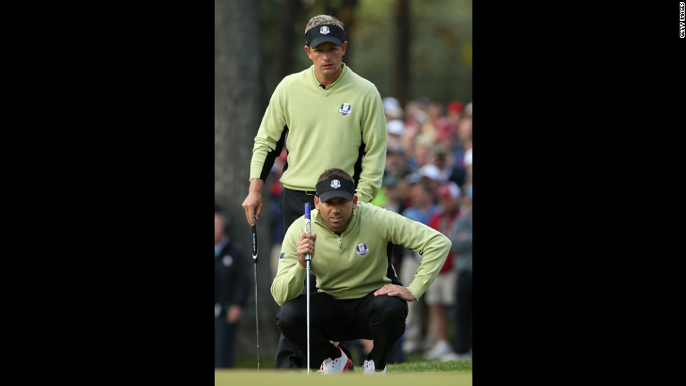 Luke Donald and Sergio Garcia of Europe line up a putt on the seventh hole on Friday.