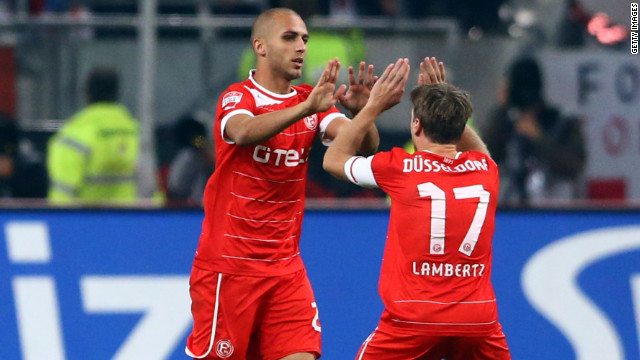 Dani Schahin scored twice as Fortuna Dusseldorf came from two goals down to grab a point in its Bundesliga clash against Schalke.