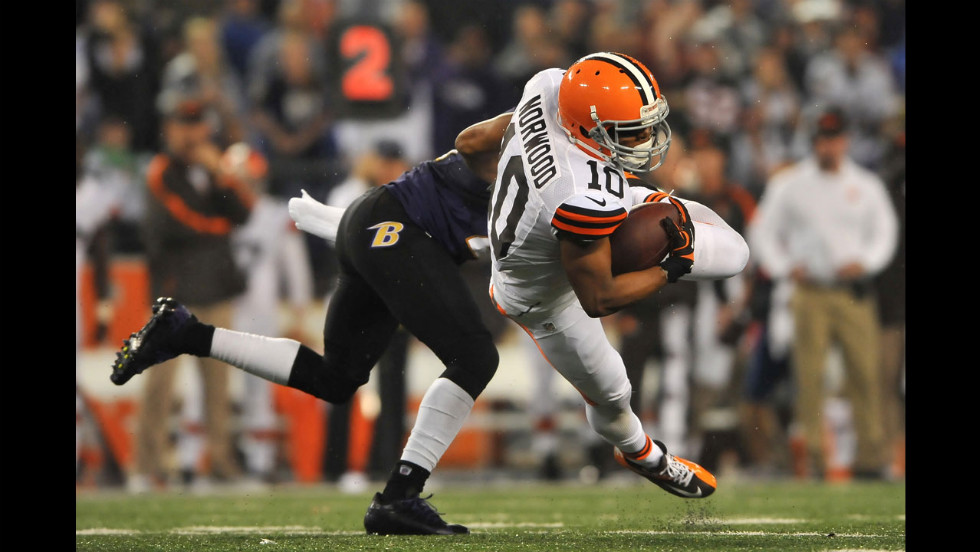 Jordan Norwood, right, of the Cleveland Browns runs the ball against the Baltimore Ravens.