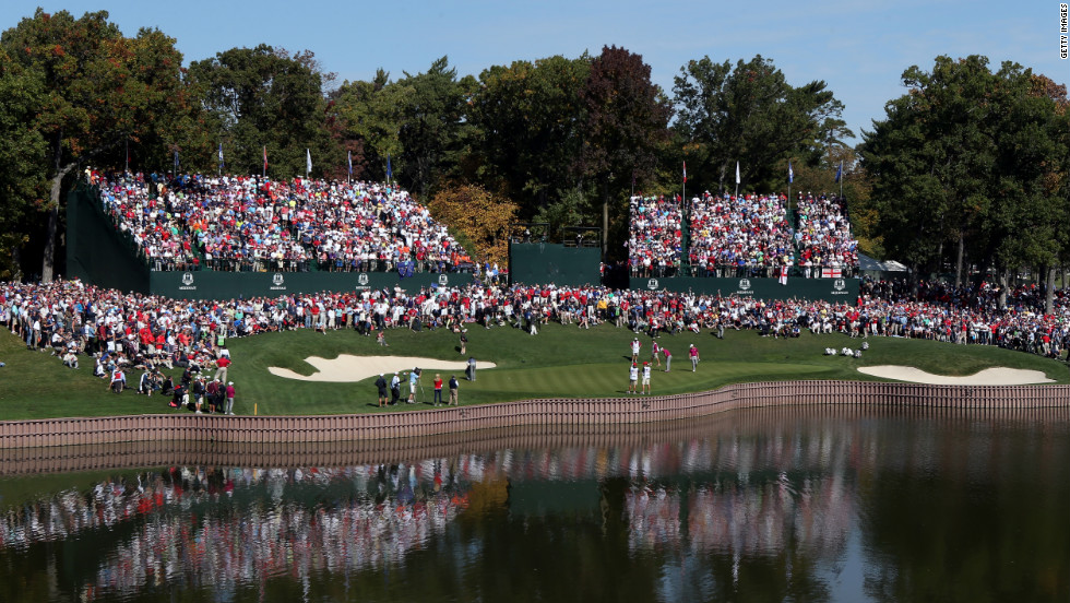 A crowd gathers at the 17th green on day two of the competition.