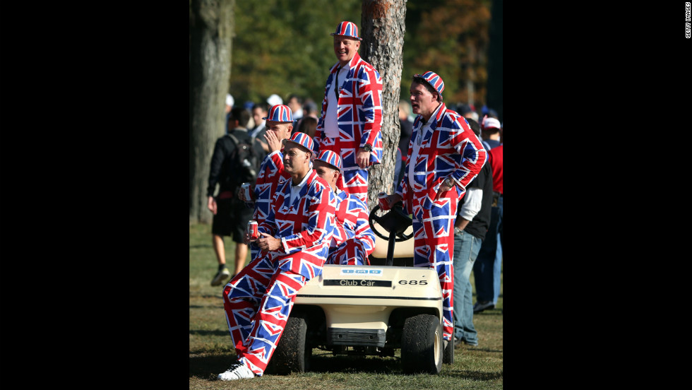 European fans watch the play from a golf cart during day two.
