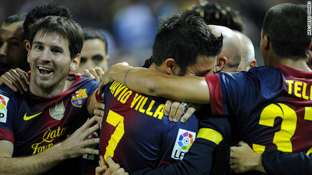 David Villa is congratulated by his teammates after scoring a dramatic late winner against Sevilla on Saturday.