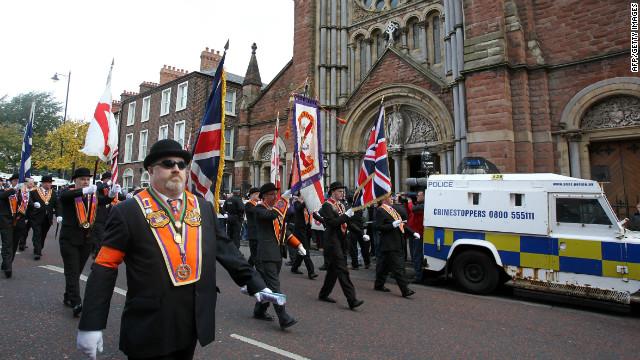 Orangemen march past St.Patrick's Catholic Church in north Belfast, Northern Ireland on September 29, 2012.