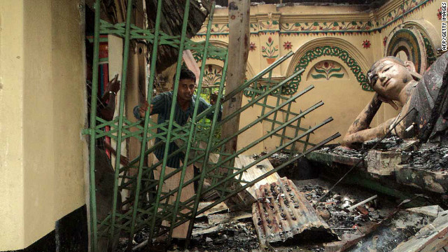 Rioters torched Buddhist temples and homes in Bangladesh over a Facebook photo deemed offensive to Islam.