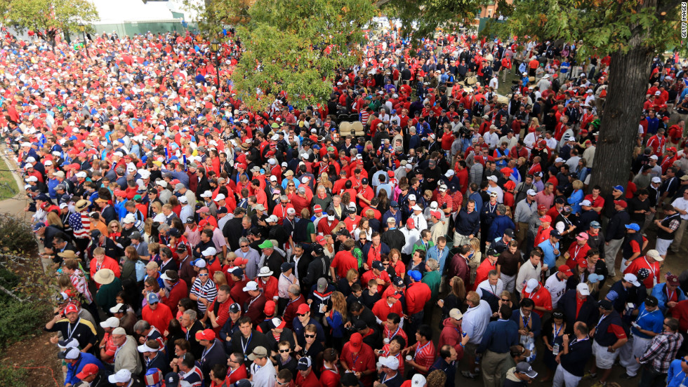 A sea of fans crowds around the first tee near the clubhouse Sunday.
